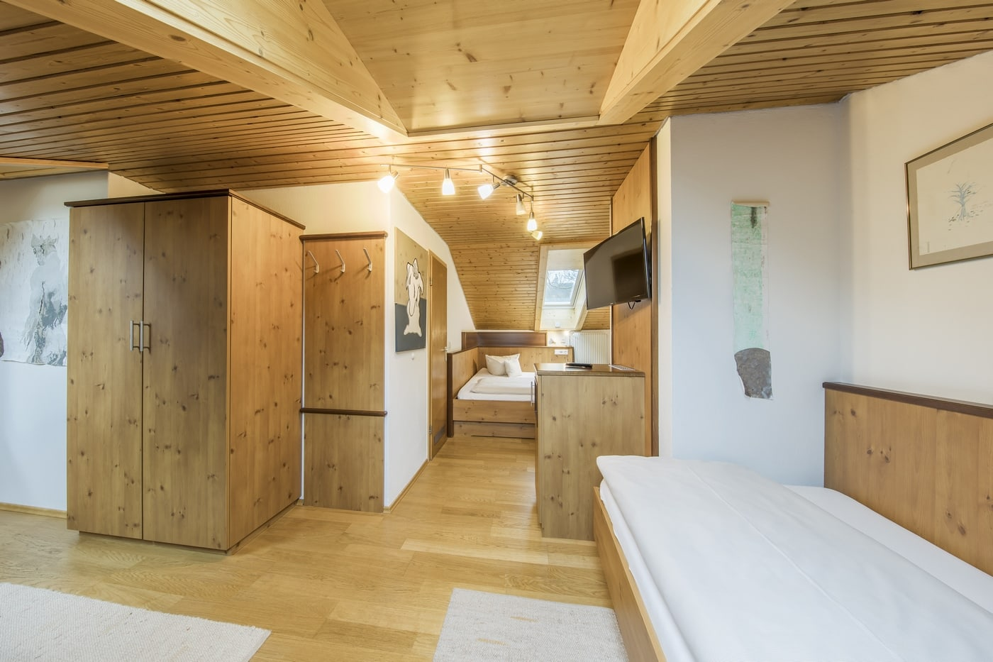 This room in the Hotel Brunner is a family or triple room and was diversely designed by Hermann-Maria Prätorius.