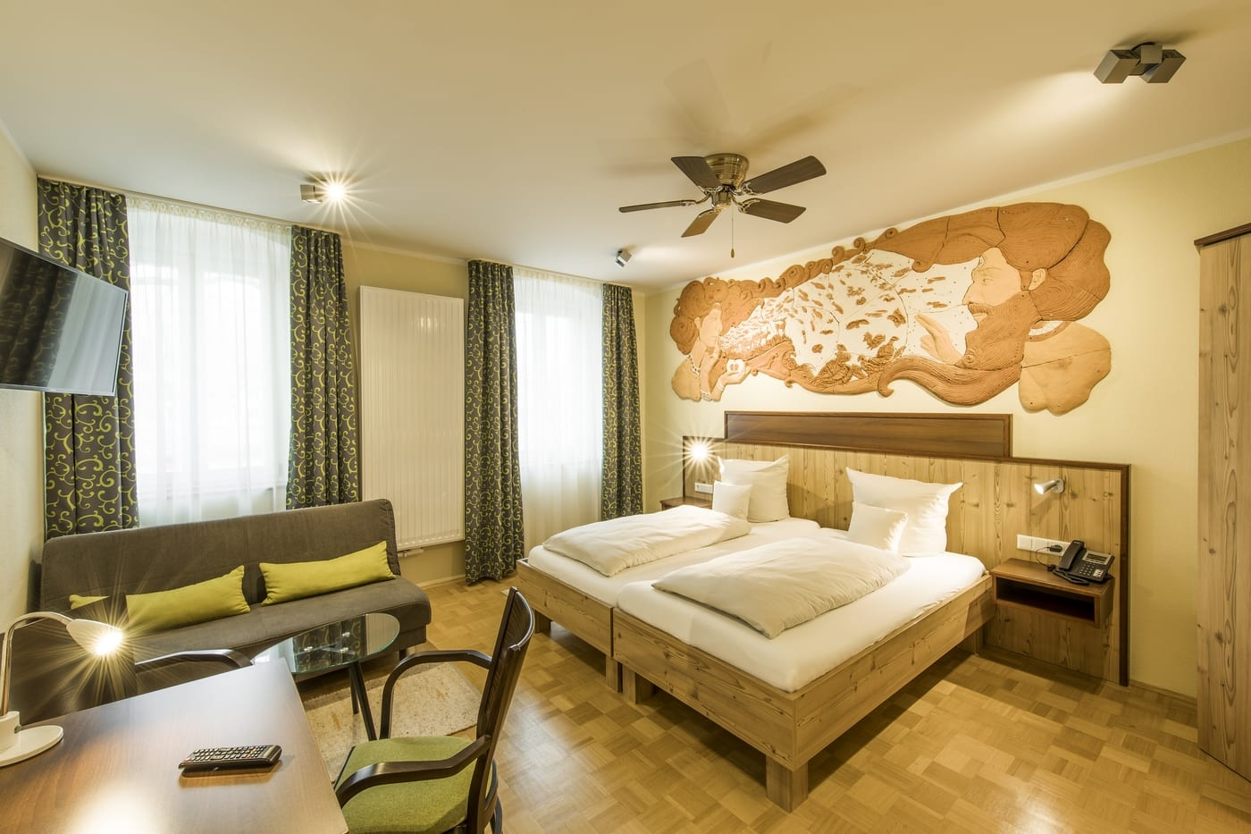 Genesis is a double room with wall-filling clay artwork created by Hungarian artist Lilian Kovács.